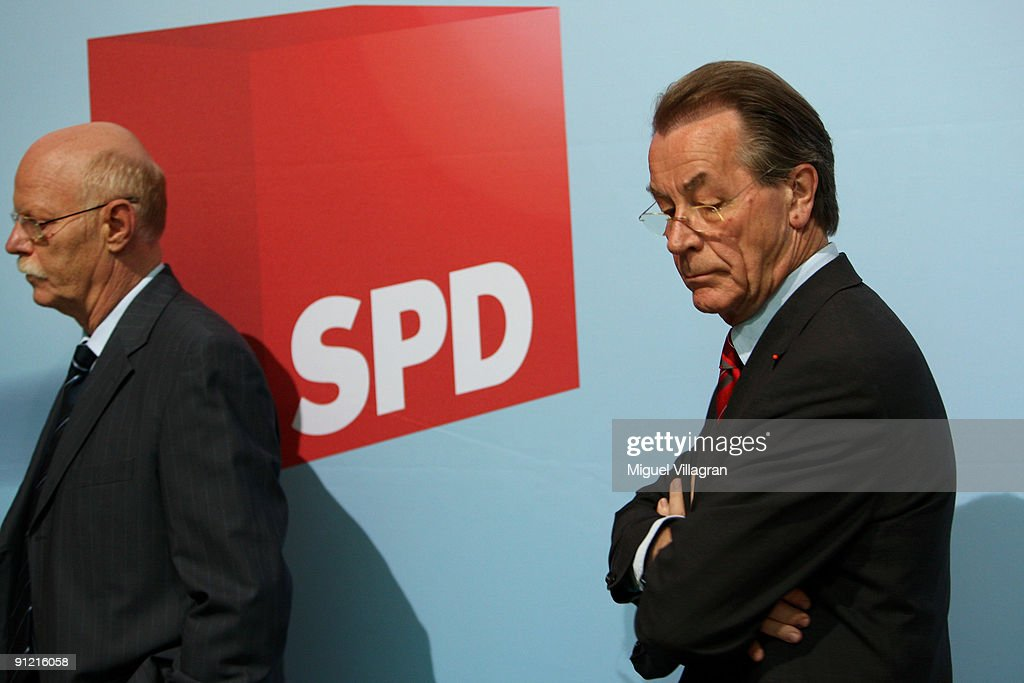 The chairman of the Social Democratic Party (SPD) <a gi-track='captionPersonalityLinkClicked' href=/galleries/search?phrase=Franz+Muentefering&family=editorial&specificpeople=214167 ng-click='$event.stopPropagation()'>Franz Muentefering</a> (R) and <a gi-track='captionPersonalityLinkClicked' href=/galleries/search?phrase=Peter+Struck&family=editorial&specificpeople=745150 ng-click='$event.stopPropagation()'>Peter Struck</a>, parliamentary group leader of Germany's social democratic party, attend a party executive board meeting on September 28, 2009 in Berlin, Germany. With 23.0 percent the SPD was the biggest loser in Germany's election.