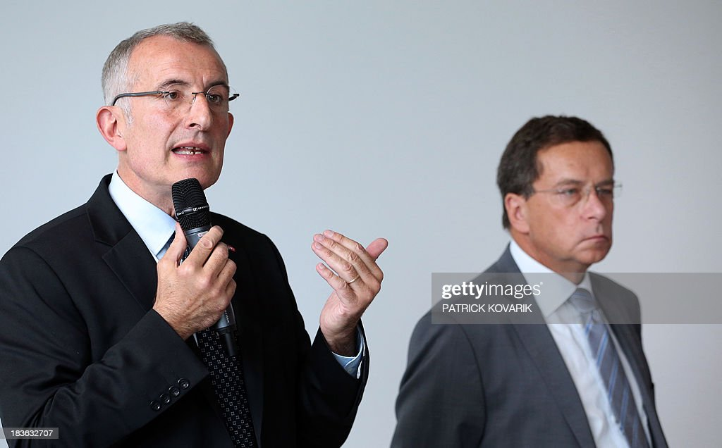 The chairman of the state-owned French rail company SNCF, Guillaume Pepy (L), speaks on October 8, 2013 next to the chairman of Reseau Ferre de France (RFF) Jacques Rapoport in the Paris suburb of La Plaine Saint-Denis as they present a maintenance plan for the network following the July 12 derailment in the Paris suburb of Bretigny-sur-Orge that left six dead. RFF owns and maintains the French national railway network.