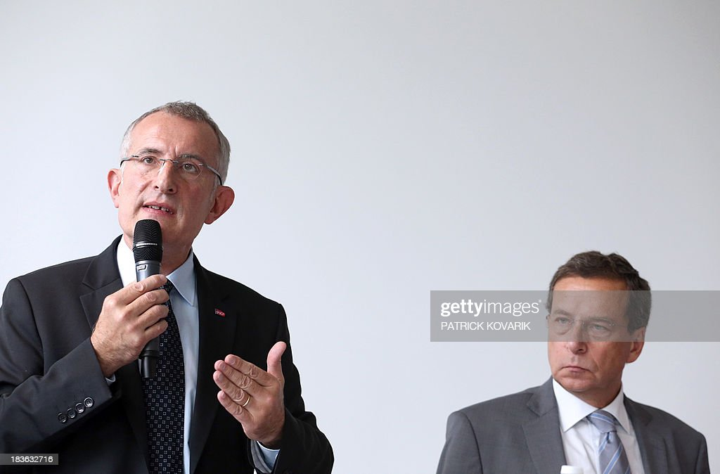 The chairman of the state-owned French rail company SNCF, Guillaume Pepy (L), speaks on October 8, 2013 next to the chairman of Reseau Ferre de France (RFF) Jacques Rapoport in the Paris suburb of La Plaine Saint-Denis as they present a maintenance plan for the network following the July 12 derailment in the Paris suburb of Bretigny-sur-Orge that left six dead. RFF owns and maintains the French national railway network. AFP PHOTO / PATRICK KOVARIK