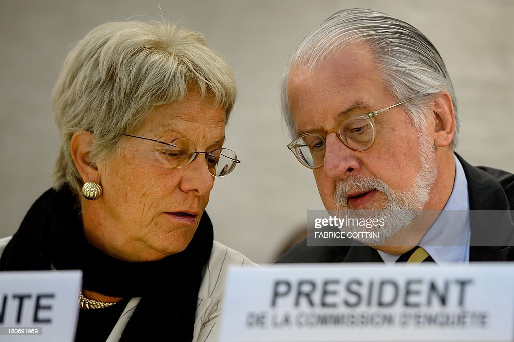 The chairperson of the United Nations (UN) Commission of Inquiry on Syria, Brazilian Paulo Sergio Pinheiro (R), speaks with commission member, Swiss Carla del Ponte, on September 16, 2013 during the presentation of their report before the Human Rights Council's members in Geneva. Chemical weapons attacks are a war crime, a UN-mandated investigator told the world body's top human rights forum, slamming a litany of abuses in war-torn Syria.