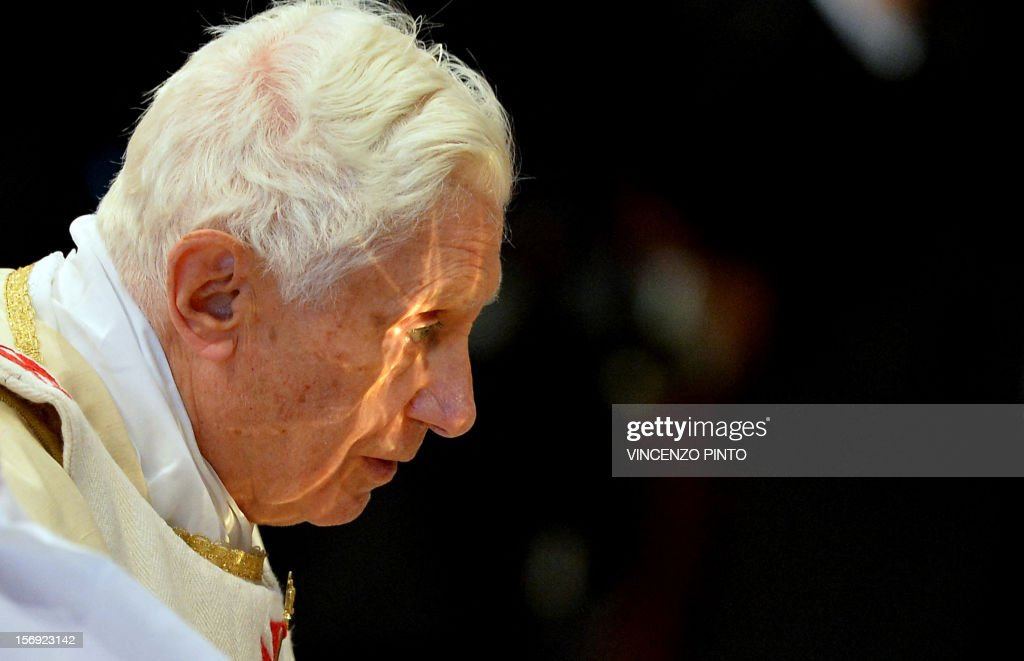 The chalice is reflected on Pope Benedict XVI's face during a Holy mass with new cardinals on November 25, 2012 at St Peter's basilica at the Vatican. Pope Benedict XVI the day before consecrated six non-European prelates as new members of the College of Cardinals in a development welcomed by critics concerned that the body which will elect the future pope is too Euro-centric.