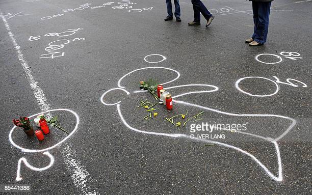 The chalk outline of the body of a teenager who went on the rampage at his former school the Winnenden Albertville secondary school in Winnenden is...