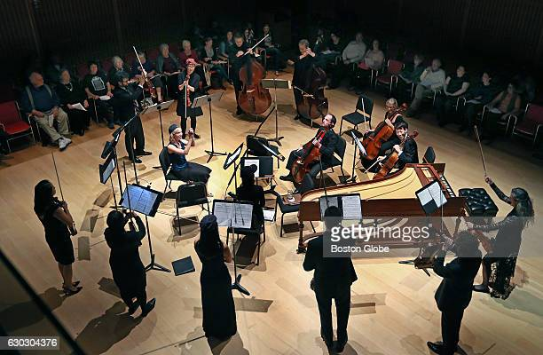 The chamber orchestra called 'A Far Cry' is pictured as they enjoy themselves at the very beginning of their performance at the Isabella Stewart...