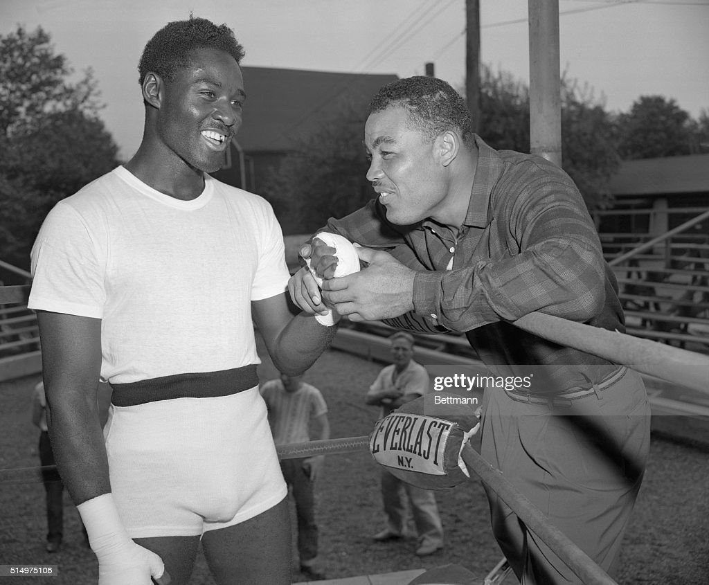 'The Champ' Visits His Heir. Pompton Lakes, New Jersey: Joe Louis, who retired as undefeated heavyweight ring champion of the world calls on the man who inherited the N.B.A. segment of his vacated throne, <a gi-track='captionPersonalityLinkClicked' href=/galleries/search?phrase=Ezzard+Charles&family=editorial&specificpeople=215068 ng-click='$event.stopPropagation()'>Ezzard Charles</a>, who is now training for his first title defense against Gus Lesnevich. Words of wisdom are imparted to Ezzard by the man who knows as Ezzard starts today's training grind in his Pompton Lakes camp.
