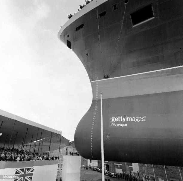 The champagne bottle smashes against the new liner as the Queen sends the Queen Elizabeth II down the ways at John Brown's yards on Clydebank