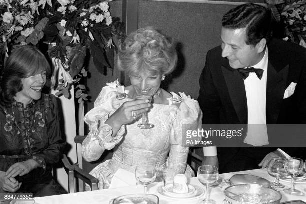 The champagne glass from the pinnacle of a pyramid is sampled by Princess Michael of Kent during last night's British Fashion Ball at Grosvenor House...