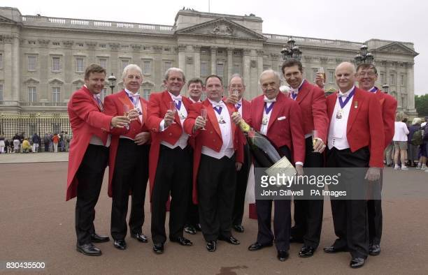 The Champagne laden Guild of International Professional toast masters wait outside Buckingham Palace for the Queen Mother The Guild members make an...
