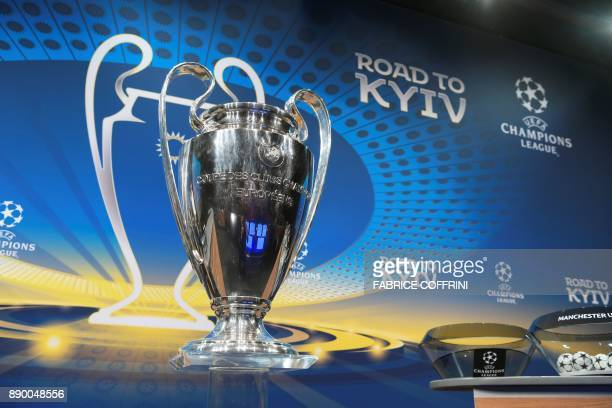 The Champions League trophy is displayed prior to the draw for the round of 16 of the UEFA Champions League football tournament at the UEFA...