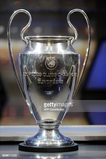 The Champions League Trophy stands on display during the UEFA Champions League football group stage draw ceremony in Monaco on August 24 2017 / AFP...