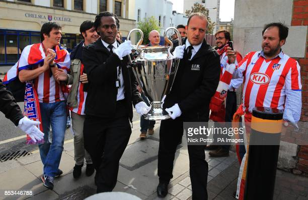 The Champions League Trophy that did a walking tour down the Fulham Broadway Road past some Atletico Madrid fans before the UEFA Champions League...