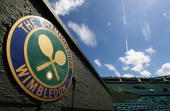 A 'The Championships' logo is seen at Centre Court during previews for the Wimbledon Lawn Tennis Championships at the All England Lawn Tennis and...