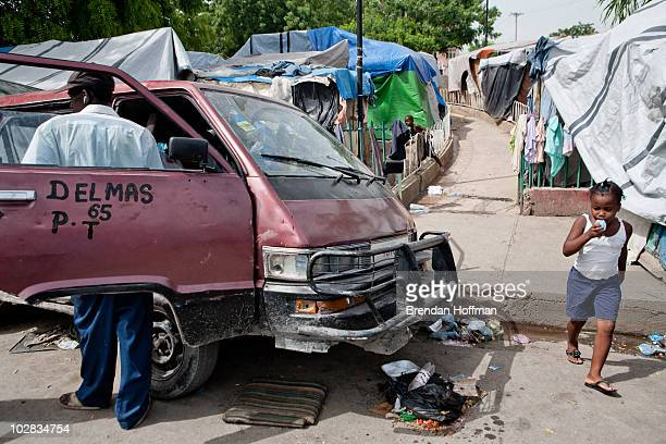 The Champs de Mars a park across from the destroyed National Palace is crowded with tents on July 12 2010 in PortauPrince Haiti Six months after an...