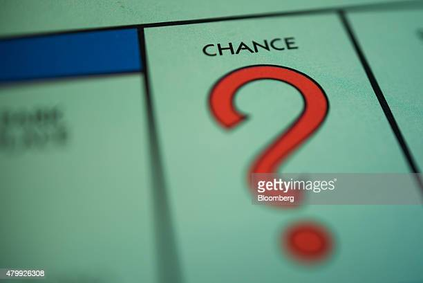 The 'Chance' square is seen on a Hasbro Inc Monopoly board game arranged for a photograph taken with a tiltshift lens in Oradell New Jersey US on...