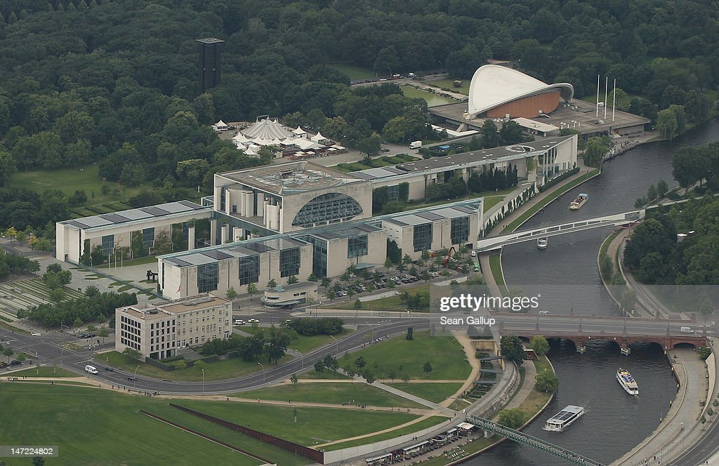 The Chancellery and the House of World Cultures stand next to the Spree river on June 27 2012 in Berlin Germany Berlin is a major tourist destination...