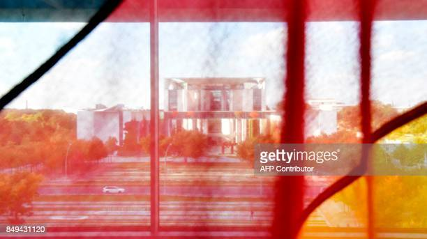 The Chancellery is pictured through a German national flag in Berlin on September 19 5 days before Germans head to the polls Germany goes to the...