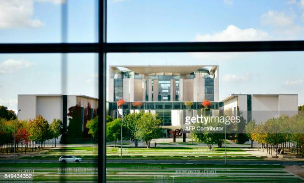 The Chancellery is pictured through a window in Berlin on September 19 5 days before Germans head to the polls Germany goes to the polls for...