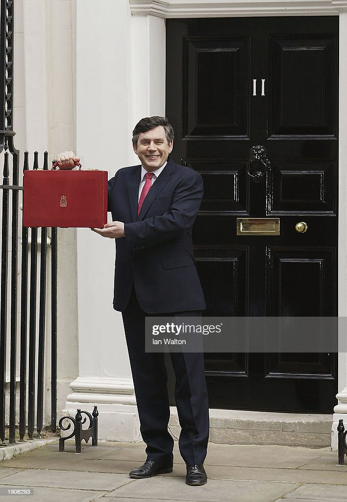 The Chancellor <a gi-track='captionPersonalityLinkClicked' href=/galleries/search?phrase=Gordon+Brown&family=editorial&specificpeople=158992 ng-click='$event.stopPropagation()'>Gordon Brown</a> holds up his briefcase, which contains the budget outside Downing Street, London on April 9, 2003.