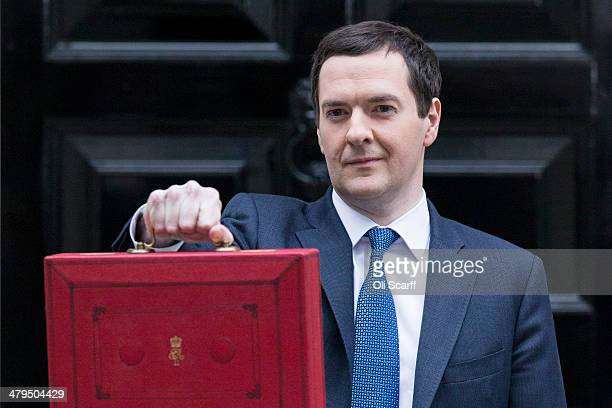 The Chancellor of the Exchequer George Osborne holding the budget box stands outside Number 11 Downing Street on March 19 2014 in London England The...