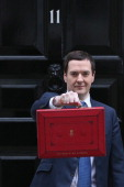 The Chancellor of the Exchequer George Osborne holding the budget box outside Number 11 Downing Street on March 19 2014 in London England The...