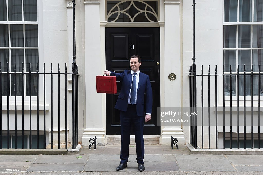 The Chancellor of the Exchequer <a gi-track='captionPersonalityLinkClicked' href=/galleries/search?phrase=George+Osborne&family=editorial&specificpeople=5544226 ng-click='$event.stopPropagation()'>George Osborne</a> holds his ministerial red box up to the media as he leaves 11 Downing Street on July 8, 2015 in London, England. The Chancellor is presenting his summer budget today to Parliament and is expected to announce £12 billion in welfare cuts.