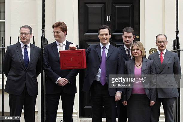 The Chancellor of the Exchequer George Osborne stands with his Treasury team Financial Secretary to the Treasury Mark Hoban Chief Secretary to the...