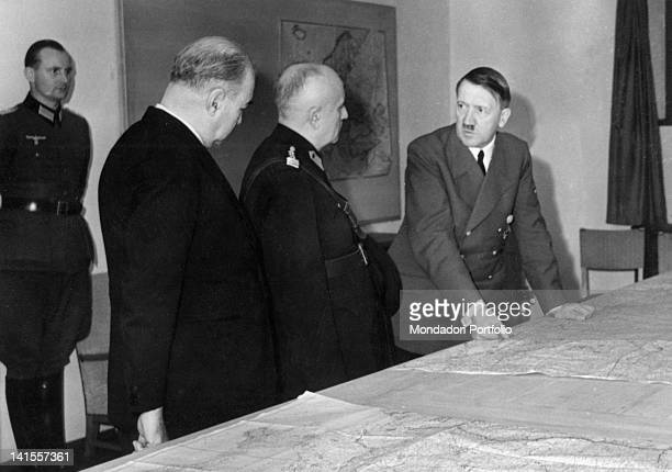 The Chancellor of the Third Reich Adolf Hitler in conversation with the Turkish general Ali Fund Erden and his lieutenant Hueseyn Erkilet Berlin...