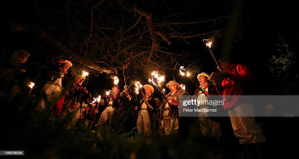 The Chanctonbury Ring Morris Men lead the singing of the wassail song during the Apple Howling ceremony at Old Mill Farm on January 5, 2013 in Bolney, England. In this ancient ritual villagers surround the oldest and largest tree in the orchard and evil spirits are driven out and good spirits are encouraged to produce a bountiful apple crop for the following year's cider drink.