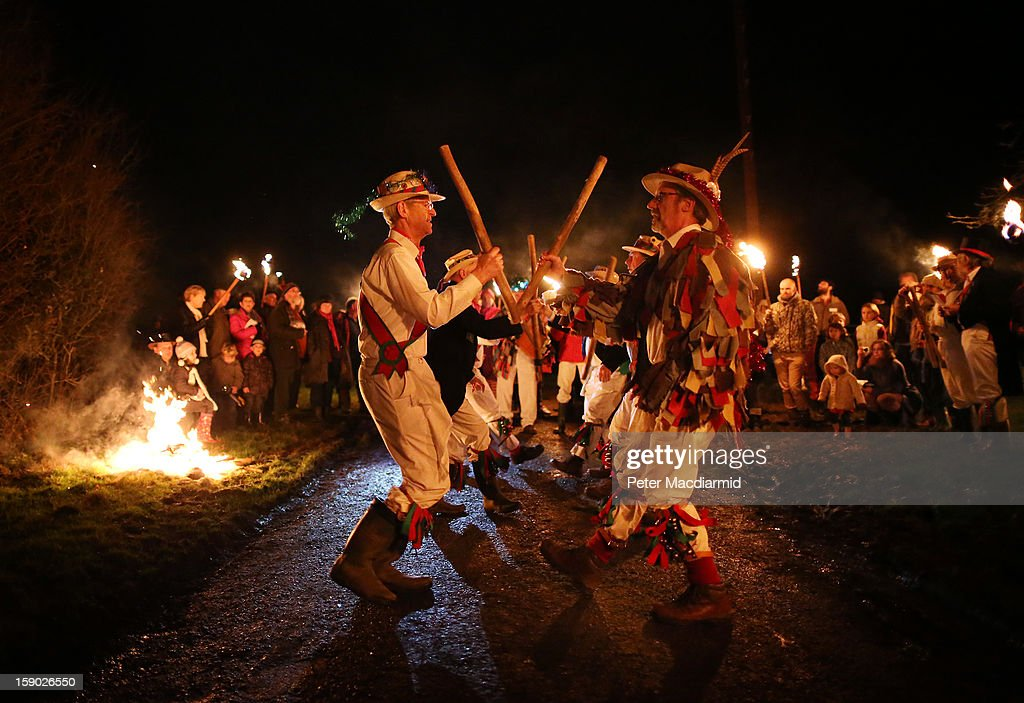 The Chanctonbury Ring Morris Men perform a traditional dance during the Apple Howling ceremony at Old Mill Farm on January 5, 2013 in Bolney, England. In this ancient ritual villagers surround the oldest and largest tree in the orchard and evil spirits are driven out and good spirits are encouraged to produce a bountiful apple crop for the following year's cider drink.