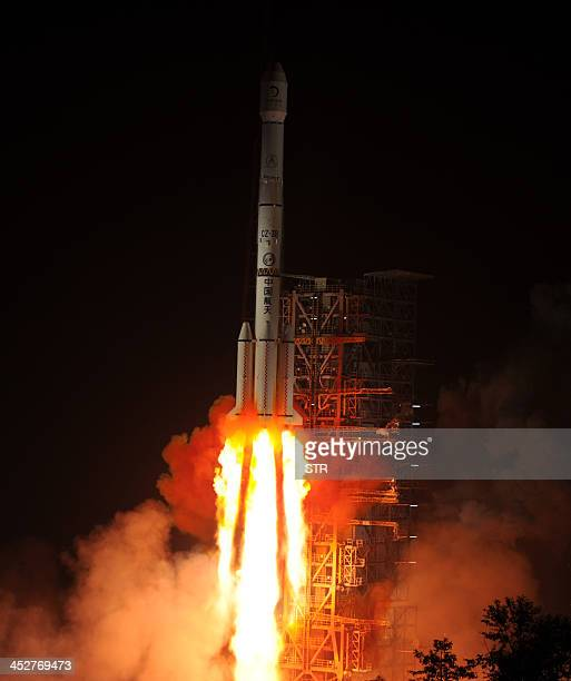 The Chang'e3 rocket carrying the Jade Rabbit rover blasts off around 130 am into the dark sky from the Xichang Satellite Launch Center in the...