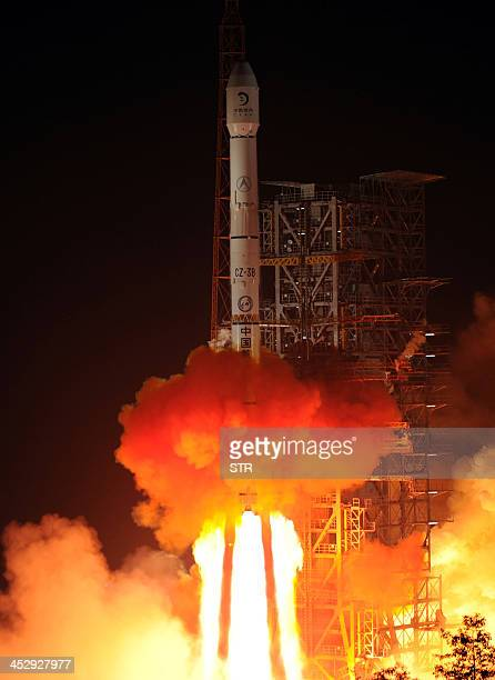 The Chang'e3 rocket carrying the Jade Rabbit rover blasts off from the Xichang Satellite Launch Center in the southwest province of Sichuan on...