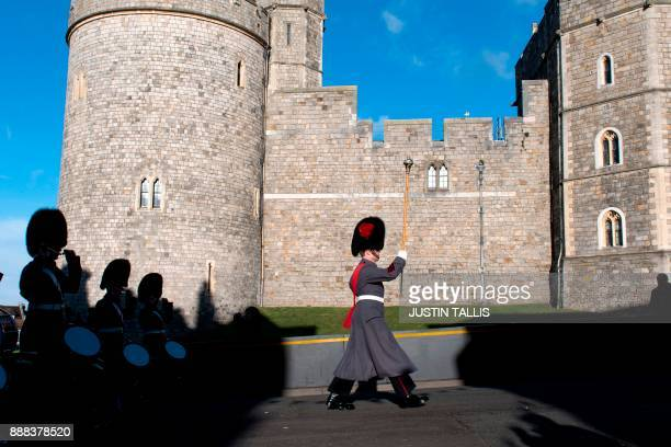 The Changing of the guard takes place outside Windsor Castle in Windsor west of London on December 8 2017 Britain's Prince Harry will marry his US...