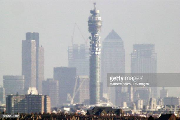 The changing skyline of London is dominated by the two new towers under construction at Canary Wharf in east London which will be occupied by...