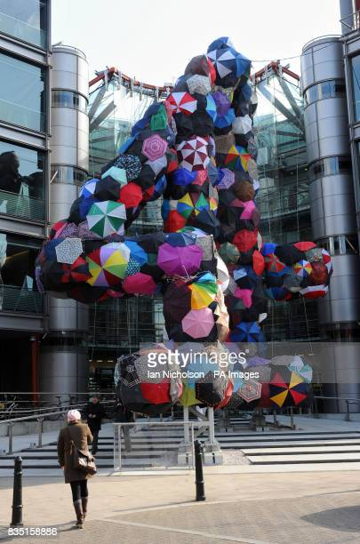 The Channel Four logo outside the TV station's London office clad in discarded umbrellas an installation called Shelter by artist Stephanie Imbeau...