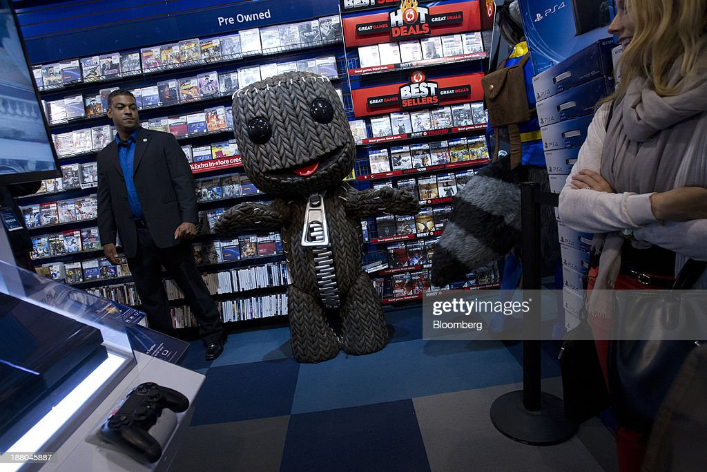 The character Sackboy from the video game LittleBigPlanet greets fans attending the Sony PlayStation 4 midnight launch event in San Francisco, California, U.S., on Thursday, Nov. 14, 2013. Sony Corp., poised to release the PlayStation 4 game console this week, is confident it can meet analysts' sales estimates of 3 million units by year-end, exploiting an early advantage over Microsoft Corp.'s Xbox One. Photographer: Erin Lubin/Bloomberg via Getty Images