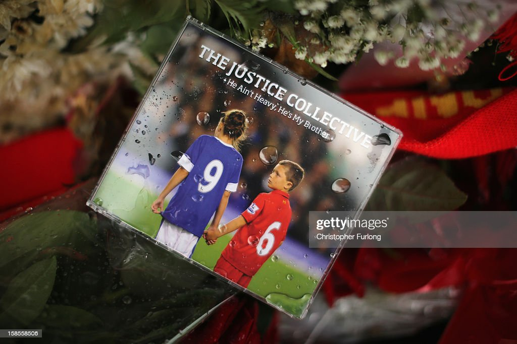 The charity single 'He Ain't Heavy, He's My Brother' by The Justice Collective sits on floral tributes at the Hillsborough Memorial outside Liverpool Football Club as the High Court quashes the 'Accidental Death' verdict on December 19, 2012 in Liverpool, England. An application presented by the Attorney General, Dominic Grieve to Lord Chief Justice Lord Judge has resulted in the quashing of the original accidental death verdict and an order for fresh inquests. The Hillsborough disaster occurred during the FA Cup semi-final tie between Liverpool and Nottingham Forest football clubs in April 1989 at the Hillsborough Stadium in Sheffield, which resulted in the deaths of 96 football fans.