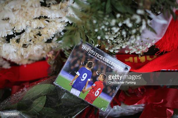 The charity single 'He Ain't Heavy He's My Brother' by The Justice Collective sits on floral tributes at the Hillsborough Memorial outside Liverpool...
