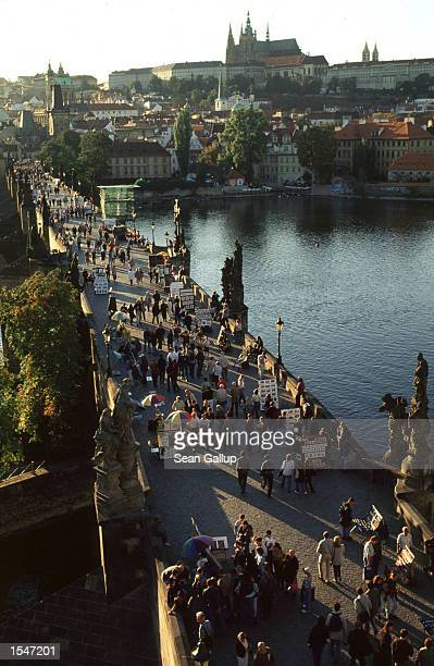 The Charles Bridge which crosses the Moldau River in Prague Czech Republic is among the city's main tourist attractions and landmarks Photo taken...