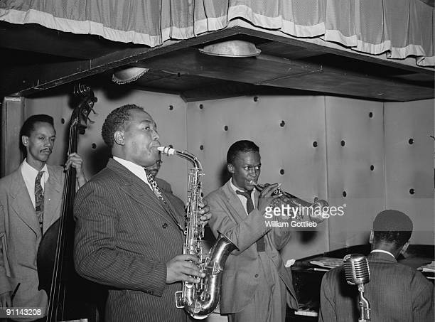 Photo of Charlie PARKER with Miles Davis Tommy Potter on bass performing live onstage on Piano performing live onstage