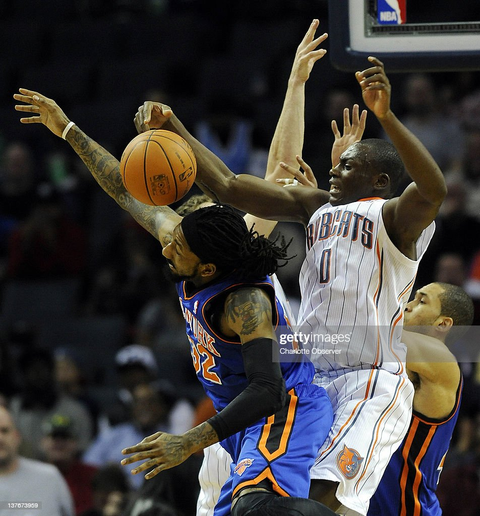 The Charlotte Bobcats' Bismack Biyombo (0) and the New York Knicks' Renaldo Balkman battle for a rebound during the second half at Time Warner Cable Arena in Charlotte, North Carolina, on Tuesday, January 24, 2012. New York rolled, 111-78.