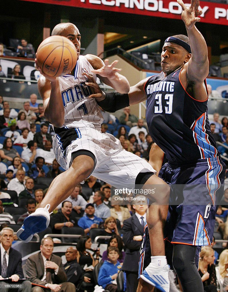 The Charlotte Bobcats' Brendan Haywood (33) stops a drive by the Orlando Magic's Arron Afflalo at the Amway Center in Orlando, Florida, on Friday, January 18, 2013. Charlotte won, 106-100.
