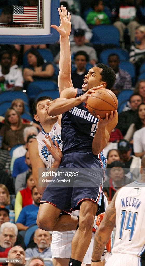 The Charlotte Bobcats' Gerald Henderson (9) drives in front of the Orlando Magic's Nikola Vucevic at the Amway Center in Orlando, Florida, on Tuesday, February 19, 2013.