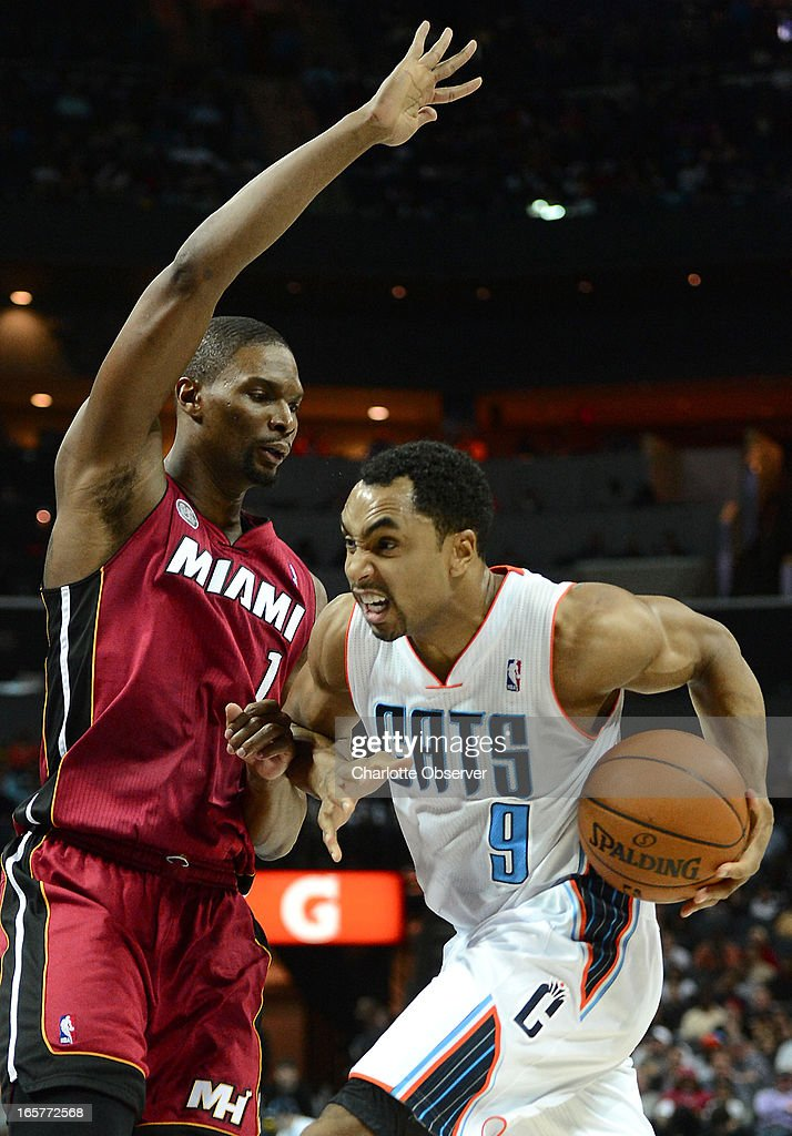 The Charlotte Bobcats' Gerald Henderson (9) drives to the basket against the Miami Heat's Chris Bosh during first-half action on Friday, April 5, 2013 at Time Warner Cable Arena in Charlotte, North Carolina.
