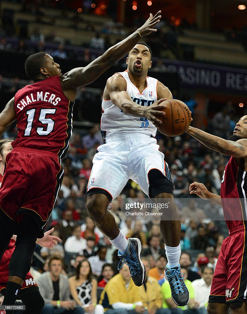 The Charlotte Bobcats' Gerald Henderson drives to the basket between Miami Heat defenders Mario Chalmers (15) and Rashard Lewis during first-half action on Friday, April 5, 2013 at Time Warner Cable Arena in Charlotte, North Carolina.