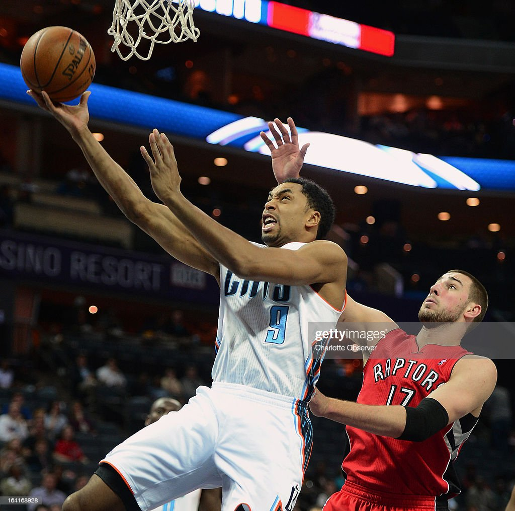 The Charlotte Bobcats' Gerald Henderson drives to the basket in front of the Toronto Raptors' Jonas Valanciunas during first-half action at Time Warner Cable Arena in Charlotte, North Carolina, on Wednesday, March 20, 2013.