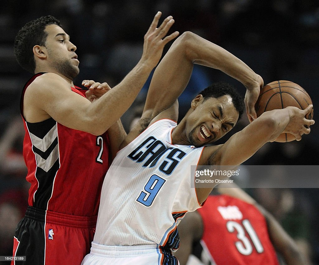The Charlotte Bobcats' Gerald Henderson fights to maintain control of the ball as the Toronto Raptors (2) and Landry Fields apply defensive pressure during second-half action at Time Warner Cable Arena in Charlotte, North Carolina, on Wednesday, March 20, 2013. Charlotte won, 107-101.
