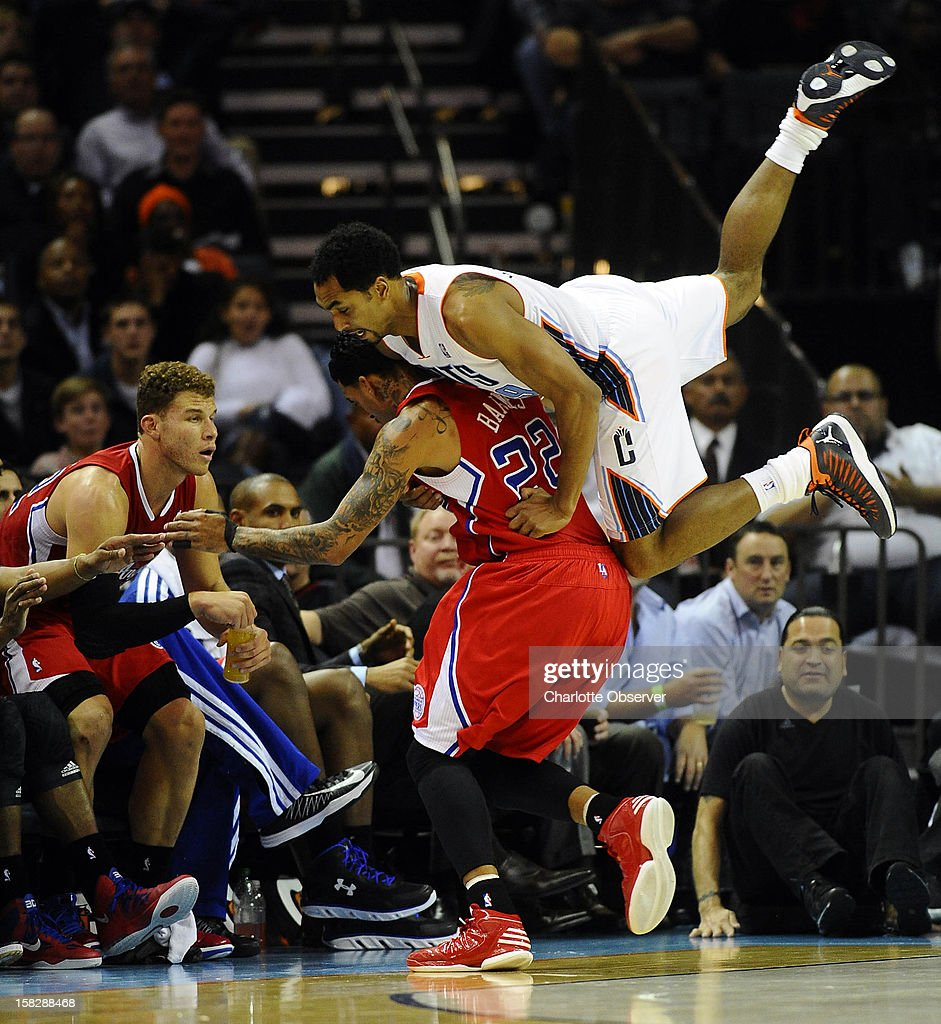 The Charlotte Bobcats' Gerald Henderson, top, gets hung up onthe Los Angeles Clippers' Matt Barnes while going after a loose ball in the second half at Time Warner Cable Arena in Charlotte, North Carolina, on Wednesday, December 12, 2012. The Clippers won, 100-94.