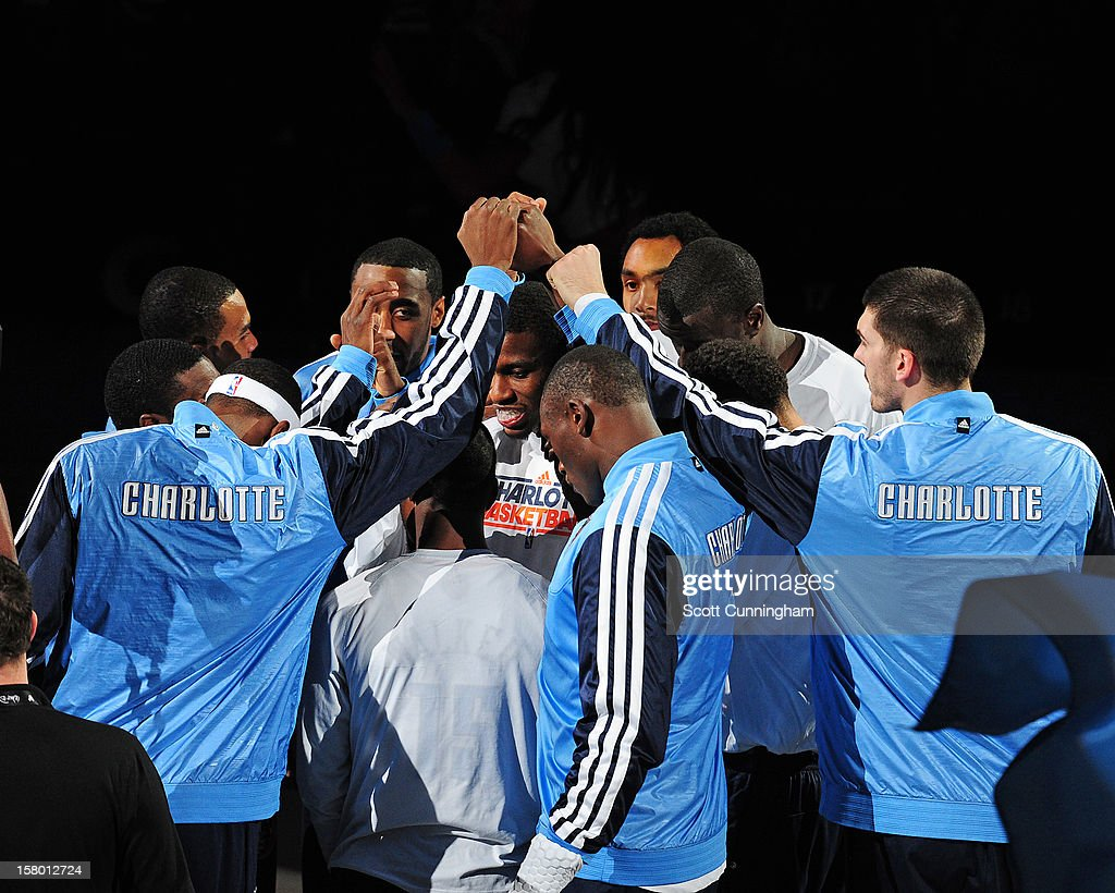 The Charlotte Bobcats huddle together during a timeout against the San Antonio Spurs at Time Warner Cable Arena on December 8, 2012 in Charlotte, North Carolina.