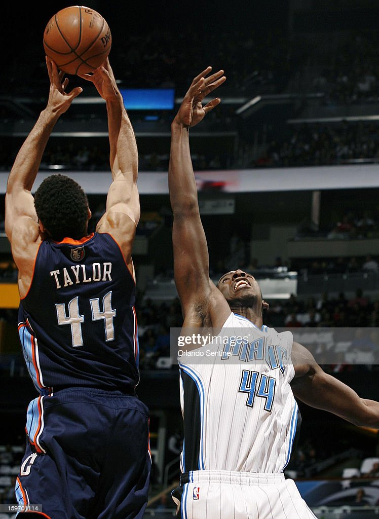 The Charlotte Bobcats' Jeffery Taylor (44) leaps to pull down a rebound over the Orlando Magic's Andrew Nicholson at the Amway Center in Orlando, Florida, on Friday, January 18, 2013.