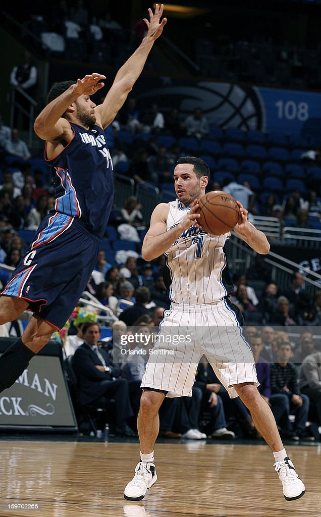 The Charlotte Bobcats' Jeffery Taylor, left, towers over the Orlando Magic's J.J. Redick (7) at the Amway Center in Orlando, Florida, on Friday, January 18, 2013. Charlotte won, 106-100.