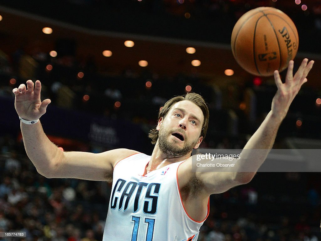 The Charlotte Bobcats' Josh McRoberts tries to get his hands on a rebound during second-half action against the Miami Heat on Friday, April 5, 2013 at Time Warner Cable Arena in Charlotte, North Carolina. Miami won, 89-79.